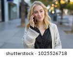 young woman walking talking on... | Shutterstock . vector #1025526718