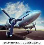 historical airplane on a runway | Shutterstock . vector #1025533240