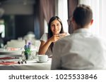 smiling woman on a date in a... | Shutterstock . vector #1025533846