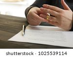 hands of wife  husband signing... | Shutterstock . vector #1025539114