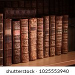 antique books on old wooden... | Shutterstock . vector #1025553940