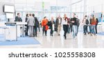 blurred people at a trade fair... | Shutterstock . vector #1025558308