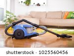 blue vacuum cleaner standing on ... | Shutterstock . vector #1025560456