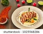grilled chicken fillet is cut...