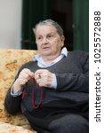 elderly woman praying selective ... | Shutterstock . vector #1025572888