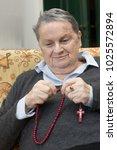 elderly woman portrait praying... | Shutterstock . vector #1025572894