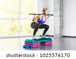 blonde woman sit ups  squad on...   Shutterstock . vector #1025576170