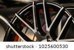car alloy wheel in store.... | Shutterstock . vector #1025600530