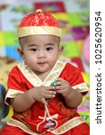 8 month old baby wearing a red... | Shutterstock . vector #1025620954