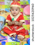 8 month old baby wearing a red... | Shutterstock . vector #1025620960