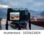 modern milc camera on a tripod...   Shutterstock . vector #1025621824
