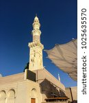 Small photo of Madinah (Medina), Saudi Arabia - circa May 2015: One of the tall minarets of Nabawi Mosque (Mosque of Prophet Muhammad) during a hot and clear afternoon.