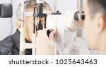 old man checking on eye in...   Shutterstock . vector #1025643463