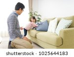 father taking care of child | Shutterstock . vector #1025644183