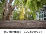 image of wooden table in front... | Shutterstock . vector #1025649334