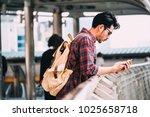 asian traveler man is standing...   Shutterstock . vector #1025658718