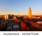 the sun sets over the state... | Shutterstock . vector #1025675146