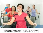 smiling woman at fitness class