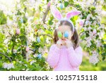 child on easter egg hunt in... | Shutterstock . vector #1025715118