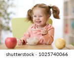 cute child eating healthy food... | Shutterstock . vector #1025740066