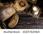 Small photo of A loaf of bread on a leaven on a dark rustic background