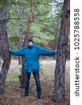a rural guy posing in a pine... | Shutterstock . vector #1025788558