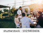 man giving a speech to group of ... | Shutterstock . vector #1025803606