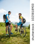 active young couple biking on a ... | Shutterstock . vector #1025818903