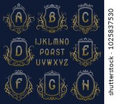 set of golden monograms with... | Shutterstock .eps vector #1025837530