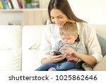 mother showing smart phone...   Shutterstock . vector #1025862646