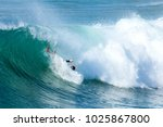 surfer in large wave wipes out... | Shutterstock . vector #1025867800