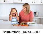 attractive woman cooking... | Shutterstock . vector #1025870680