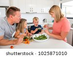 young attractive couple mother... | Shutterstock . vector #1025871010
