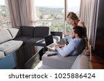 young couple relaxing at  home... | Shutterstock . vector #1025886424