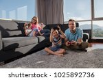 happy family. father  mother... | Shutterstock . vector #1025892736