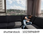 young man sitting on sofa and... | Shutterstock . vector #1025896849