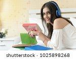 beautiful smiling young woman... | Shutterstock . vector #1025898268