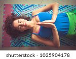 young yoga woman lying on mat... | Shutterstock . vector #1025904178