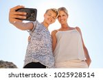 teenager son and mother posing... | Shutterstock . vector #1025928514