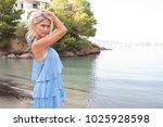 beautiful middle age caucasian... | Shutterstock . vector #1025928598