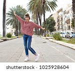 beautiful dynamic young woman... | Shutterstock . vector #1025928604