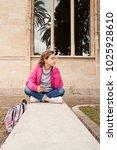 teenager girl sitting on... | Shutterstock . vector #1025928610