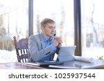 hardworking tired draftsman... | Shutterstock . vector #1025937544