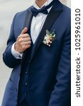 stylish groom posing on... | Shutterstock . vector #1025961010