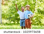 two multicultural boys as... | Shutterstock . vector #1025973658