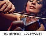 A Girl Plays The Viola Perform...