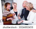 mature friends are meeting for... | Shutterstock . vector #1026002653