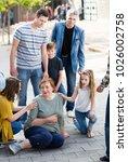 relatives standing near their...   Shutterstock . vector #1026002758