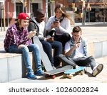 smiling group teens playing on... | Shutterstock . vector #1026002824