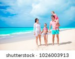happy beautiful family of four... | Shutterstock . vector #1026003913